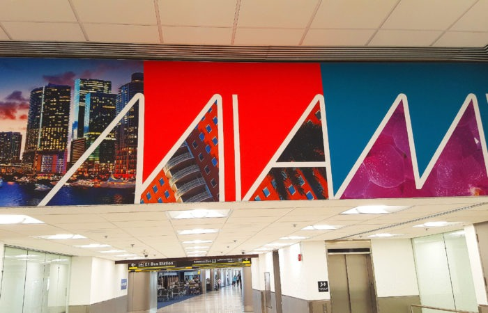 Sign reading 'Miami' in the Miami airport